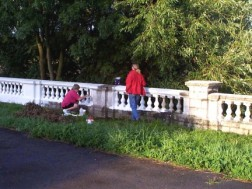 Two of our volunteers painting the promenade ornamental wall on theriverfront of Dukes Meadows.